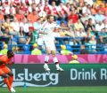 Football - Holland v Denmark - UEFA EURO 2012 Group B  - Metalist Stadium, Kharkiv, Ukraine - 9/6/12Match Action, Denmark's Dennis Rommedahl heads the ball, Carlsberg BoardMandatory Credit: Action Images / Peter Cziborra